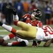 San Francisco 49ers' Patrick Willis (52) tackles Atlanta Falcons' Matt Ryan (2) after a short run during the second half of the NFL football NFC Championship game Sunday, Jan. 20, 2013, in Atlanta. (AP Photo/Mark Humphrey)