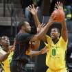 Southern California's Byron Wesley, center, passes the ball under pressure from Oregon's Damyean Dotson, left, and Mike Moser, right, during the first half of an NCAA college basketball game in Eugene, Ore. on Saturday, Feb. 1, 2014. (AP Photo/Chris Pietsch)