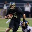 Baylors Bryce Petty (14), left, runs for extra yardage past West Virginia linebacker Jared Barber (33), right, during the first half of an NCAA college football game on Saturday, Oct.  5, 2013, in Waco, Texas. (AP Photo/Rod Aydelotte)