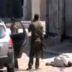 This image made from amateur video and released by Syrian Media Centre Friday, April 13, 2012 purports to show a dead body next to Syrian soldiers in Daraa, Syria. (AP Photo/Douma Revolution in Syria via AP video) THE ASSOCIATED PRESS CANNOT INDEPENDENTLY VERIFY THE CONTENT, DATE, LOCATION OR AUTHENTICITY OF THIS MATERIAL. TV OUT