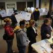 Voters pack the polling place at First Christian Church, 1826 16th Street in Moline, Ill. on Tuesday Nov. 6, 2012. The morning rain hasn't deterred voters from heading to the polls today with long lines reported at numerous polling places. (AP Photo/The Dispatch, ) QUAD CITY TIMES OUT