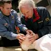 Lt. Chad Weaver (left) helps Larry Rose, of Edmond, during a CPR class at the Edmond Fire Department at 5300 Covell Road in Edmond, Okla., on Tuesday, March 30, 2010. Photo by John Clanton, The Oklahoman