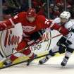 Detroit Red Wings center Damien Brunner (24) and Los Angeles Kings center Jarret Stoll (28) battle for the puck during the first period of an NHL hockey game in Detroit, Wednesday, April 24, 2013. (AP Photo/Carlos Osorio)