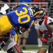 St. Louis Rams running back Zac Stacy (30) dives into the end zone for a 1-yard touchdown run as Tampa Bay Buccaneers safety Dashon Goldson, right, defends during the second quarter of an NFL football game on Sunday, Dec. 22, 2013, in St. Louis. (AP Photo/L.G. Patterson)
