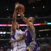 Los Angeles Clippers center Ryan Hollins, left, defends as Phoenix Suns guard Kendall Marshall drives to the basket in the first half of an NBA basketball game in Los Angeles on Wednesday, April  3, 2013. (AP Photo/Richard Hartog)