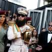 Sacha Baron Cohen, right, and guest arrive before the 84th Academy Awards on Sunday, Feb. 26, 2012, in the Hollywood section of Los Angeles. (AP Photo/Matt Sayles) ORG XMIT: OSC226