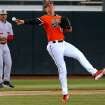 OSU's Craig McConuagy throw back to first for anout in the second inning of a Bedlam baseball game between Oklahoma State University and the University of Oklahoma in Stillwater, Okla., Tuesday, April 15, 2014. Photo by Bryan Terry, The Oklahoman