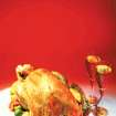 A roast turkey on a plate and wine glasses (clip art)