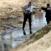 Officials investigate a scene where a body was found near General Pershing and Villa  in Oklahoma City on Tuesday, Feb. 10, 2009. By John Clanton, The Oklahoman