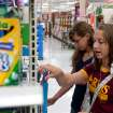 Elise Widmer ,14, (right) and her sister Claire Widmer ,12, (left) shop for school supplies. Students shop for school supplies at Walmart in Oklahoma City, Okla on Tuesday June 20, 2010. Photo by Mitchell Alcala, The Oklahoman