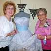 Cheyenne Middle School\'s FCCLA (Family, Career and Community Leaders of America) served as greeters,interacted with neighbors down the street at Touchmark at Coffee Creek\'s \'senior\' prom recently. Josie Codispoti, left, and Flo Owens with 1957 prom dress.