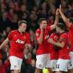 Manchester United's Robin van Persie, third left, celebrates his hatrick and scoring his side's third goal with his teammates during their Champions League last 16 second leg soccer match against Olympiakos at Old Trafford Stadium, Manchester, England, Wednesday, March 19, 2014. (AP Photo/Jon Super)