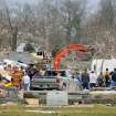 Emergency responders work to clear debris in a neighborhood in Harrisburg, Ill., after an early morning tornado Wednesday, Feb. 29, 2012. At least six people died in Harrisburg in the pre-dawn tornado.  (AP Photo/Stephen Lance Dennee) ORG XMIT: ILLD107