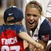 United States player Jennie Finch celebrates with her son Ace following their win over Australia at the championship game at the World Cup of Softball at ASA Hall of Fame Stadium in Oklahoma City, Monday, July 20, 2009. By John Clanton, The Oklahoman