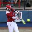 OU's Lauren Chamberlain drives a base hit during the University of Oklahoma - Louisiana State University game at