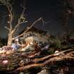 Broken branches and household debris are scattered across a lawn early Wednesday morning, Feb. 29, 2012 in Harveyville, Kan., after an apparent tornado passed through the town Tuesday night. Kansas Gov. Sam Brownback declared a state of emergency late Tuesday after a powerful storm system pounded the state's midsection. (AP Photo/Emporia Gazette, Matthew Fowler) ORG XMIT: KSEMP101