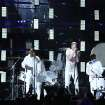 Kendrick Lamar, center left, and Dan Reynolds, center right, perform at the 56th annual Grammy Awards at Staples Center on Sunday, Jan. 26, 2014, in Los Angeles. (Photo by Matt Sayles/Invision/AP)