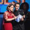 Gloria Estefan, left, and Marc Anthony present the award for best pop vocal album at the 56th annual Grammy Awards at Staples Center on Sunday, Jan. 26, 2014, in Los Angeles. (Photo by Matt Sayles/Invision/AP)