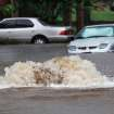 Water erupts like a geyser from an access opening in the street near Eubanks and Francis. Torrential rain caused flooding in Oklahoma City, Monday, June 14, 2010.     by Jim Beckel, The Oklahoman