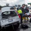 Emergency workers transport an injured woman following a multi-vehicle collision on Interstate 80 in Berkeley, Calif., Monday, Nov. 9, 2015. A storm crossed the region Monday morning bringing rain, thunder and lightning to the drought-parched region. (AP Photo/Noah Berger)