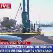 This still frame made from WABC-TV video on Saturday, July 27, 2013, shows a boat recovered from the Hudson River following a boating accident near Piermont, N.Y.  The Coast Guard says a recreational boat struck a barge near the Tappan Zee Bridge on Friday night, sending two people into the water who haven't been found and injuring four others. (AP Photo/WABC-TV)