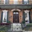 This 2012 photo shows a home with ornate ironwork fencing and a balcony in Mobile, Alabama. The city's downtown streets are lined with homes and businesses decorated with the picturesque lacy-patterned ironwork. (AP Photo/Beth J. Harpaz)