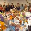 Rose State College Students in Free Enterprise gather around a room full of toys and clothes donated to benefit the children of Integris Mental Health Center.  Community Photo By:  Steve Reeves  Submitted By:  natalie,
