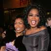 "PRODUCTION / THEATER: Talk show host Oprah Winfrey, right, hugs actress Angela Bassett as they arrive to the opening night of Winfrey's new Broadway play ""The Color Purple"" on Thursday, Dec. 1, 2005, in New York. (AP Photo/Dima Gavrysh)"