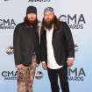 "Brothers Willie Robertson, right, and Jase Robertson, of ""Duck Dynasty,"" arrive at the 47th annual CMA Awards at Bridgestone Arena on Wednesday, Nov. 6, 2013, in Nashville, Tenn. (Photo by Evan Agostini/Invision/AP)"