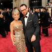 Kristin Chenoweth, left, and Dana Brunetti arrive at the Oscars on Sunday, March 2, 2014, at the Dolby Theatre in Los Angeles.  (Photo by Chris Pizzello/Invision/AP)