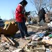 Shirley Mose looks through the debris of her home following deadly storms around Lone Grove, Okla., Feb. 11, 2009. By John Clanton, The Oklahoman
