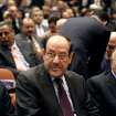 Iraqi Prime Minister Nouri al-Maliki, center, attends the first session of parliament in the heavily fortified Green Zone in Baghdad, Iraq, Tuesday, July 1, 2014. Iraq's new parliament ended its inaugural session Tuesday after failing to make any progress in choosing a new prime minister even as the country faces a militant blitz that threatens to rip it apart and a spike in violence that made June the deadliest month in at least two years. (AP Photo/Karim Kadim)