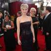 Jennifer Lawrence arrives at the 20th annual Screen Actors Guild Awards at the Shrine Auditorium on Saturday, Jan. 18, 2014, in Los Angeles. (Photo by Matt Sayles/Invision/AP)