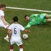 Germany's Thomas Mueller, left, scores his side's 4th goal during the group G World Cup soccer match between Germany and Portugal at the Arena Fonte Nova in Salvador, Brazil, Monday, June 16, 2014.  (AP Photo/Francois Marit, pool)