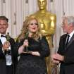 Adele and Paul Epworth pose with their award for best original song for