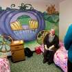 Patricia Rowe, supervisor and trainer at the Pauline A. Mayer Children's Shelter in Oklahoma City, sits near a colorful mural of a fairy tale scene that makes the room one of the most popular for young girls. Photo taken during a tour on Monday,  Jan. 23, 2012.   Photo by Jim Beckel, The Oklahoman