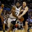 NBA BASKETBALL CHAMPIONSHIP: New Jersey Nets' Aaron Williams, right, fouls San Antonio Spurs' Malik Rose, left, as Rose drives to the basket during the first quarter of Game 1 of the NBA Finals in San Antonio, Wednesday, June 4, 2003. (AP Photo/Donna McWilliam)