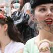 Daphne Malfitano, of the Brooklyn borough of New York, right, smiles as she and others take part in the Easter Parade along New York's Fifth Avenue Sunday April 24, 2011. (AP Photo/Tina Fineberg)