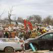 Emergency responders work to clear debris in a neighborhood in Harrisburg, Ill., after an early morning tornado Wednesday, Feb. 29, 2012. At least six people died in Harrisburg in the pre-dawn tornado.  (AP Photo/Stephen Lance Dennee) ORG XMIT: ILLDF108