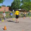 Yukon Police Sgt. Matt Fairchild teaches a bicycle safety class at Shedeck Elementary School in Yukon.  PHOTO PROVIDED BY YUKON POLICE DEPARTMENT
