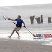 Kite boarder Pete Nero secures his kite as darks clouds and rain move in on the north end of Carolina Beach, N.C., Thursday, July 3, 2014. Residents along the coast of North Carolina are bracing for the arrival of the Hurricane Arthur, which threatens to give the state a glancing blow on Independence Day. (AP Photo/Wilmington Star-News, Mike Spencer)