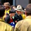 Claire Veseth, mother of fallen forest firefighter Anne Veseth, is escorted by U.S. Forest Service Honor Guard Commander Ed Martinez from her daughter's funeral at Moscow, Idaho, on Saturday, Aug.18, 2012, which was attended by two hundred firefighters from the region. Idaho experienced one of its worst wildfire seasons, with 1,151 wildfires tallied and a nation-leading 2,600 square miles burned, the most in the state since 2007, according to the National Interagency Fire Center. (AP Photo/Lewiston Tribune, Barry Kough)