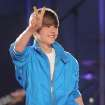 Justin Bieber gestures towards the crowd while performing during the Juno Awards in St. John's, Canada, on Sunday April 18, 2010. (AP Photo/The Canadian Press, Mike Dembeck) ORG XMIT: XMD107