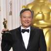Ang Lee poses with his award for best directing for