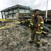 Firefighter Ben Sisti of Goodwill Fire Co. #2 stands amidst rubble where the boardwalk and the Spring Lake pavilion were destroyed by Sandy, Tuesday, Oct. 30, 2012 in Point Pleasant, N.J. (AP Photo/The Record (Bergen County), Kevin R. Wexler)  ONLINE OUT; MAGS OUT; TV OUT; INTERNET OUT;  NO ARCHIVING; MANDATORY CREDIT ORG XMIT: NJHAC101
