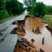 A portion of Britton Road between Sooner and Air Depot was washed away by flooding waters. Torrential rain caused flooding in Oklahoma City, Monday, June 14, 2010. Photo by Jim Beckel, The Oklahoman