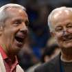 North Carolina head coach Roy Williams, left, laughs with Orlando Magic senior vice president Pat Williams during the first half of an NBA basketball game against the Denver Nuggets in Orlando, Fla., Friday, Nov. 2, 2012. Roy Williams was in attendance to support Magic head coach Jacque Vaughn who was coaching his first NBA game. (AP Photo/Phelan M. Ebenhack)