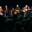 All the peformers of the Woody Guthrie Centennial Concert including Taylor Hanson, Rosanne Cash, Nora Guthrie, John Mellencamp, Arlo Guthrie, Del McCoury, Tim O'Brien and Hanson perform