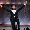 Host Hugh Jackman performs onstage at the 68th annual Tony Awards at Radio City Music Hall on Sunday, June 8, 2014, in New York. (Photo by Evan Agostini/Invision/AP)