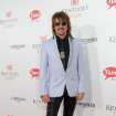 IMAGE DISTRIBUTED FOR LONGINES - Bon Jovi guitarist Richie Sambora walks the Kentucky Derby Red Carpet, Saturday, May 3, 2014, in Louisville, Ky. Longines, the Swiss watchmaker known for its famous timepieces, is the Official Watch and Timekeeper of the 140th annual Kentucky Derby. (Photo by Diane Bondareff/Invision for Longines/AP Images)